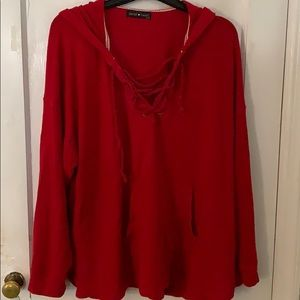 Red hoodie with rope detail.